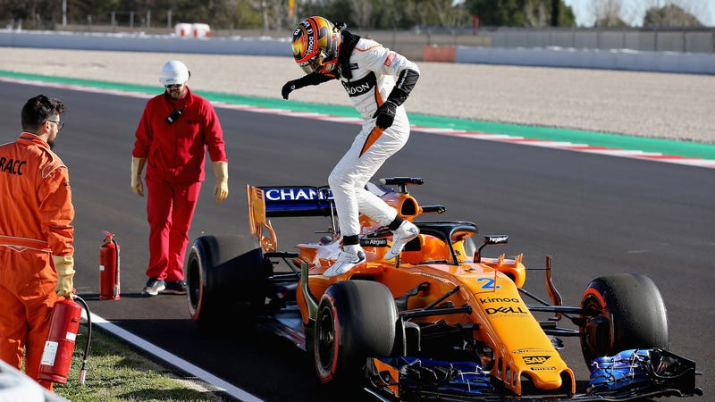 Stoffel Vandoorne climbing out of his car after stopping on track during preseason testing at Circuit de Catalunya in Barcelona.