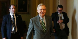 Senate Minority Leader Mitch McConnell (R-Ky.) arrives at the U.S. Capitol Oct. 14, 2013. (Mark Wilson/Getty Images)
