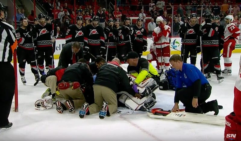Illustration for article titled Eddie Lack Stretchered Off Ice After Getting Wrecked While Giving Up OT Goal [Update]