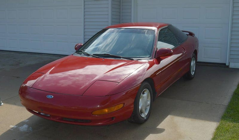 Illustration for article titled For $600, Could This 1994 Ford Probe Be Your Lockless Monster?
