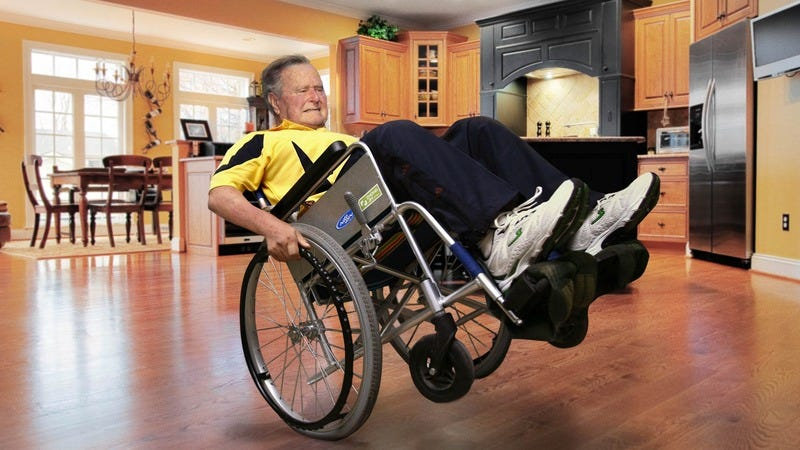 George H.W. Bush tipped back in his wheelchair.