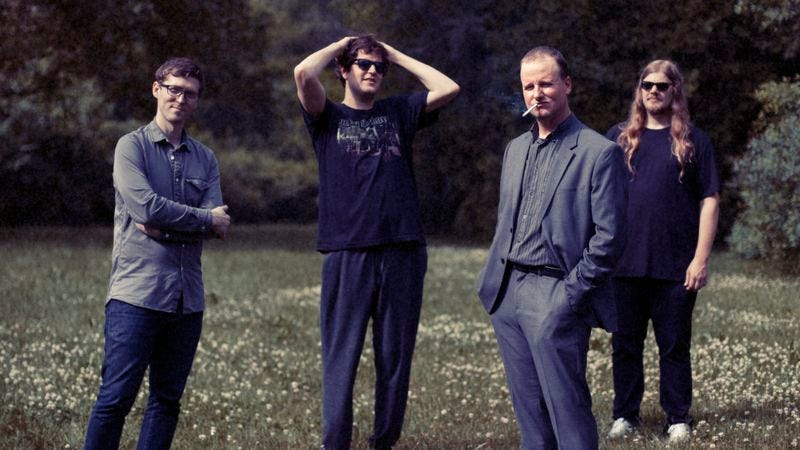 Casey, third from left, with the rest of Protomartyr