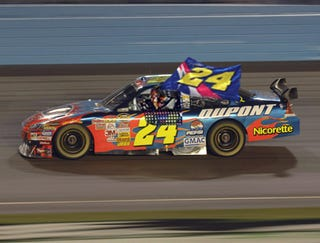 Illustration for article titled Jeff Gordon Celebrates Equaling Earnhardt's Win Record With Giant Flag Honoring Jeff Gordon