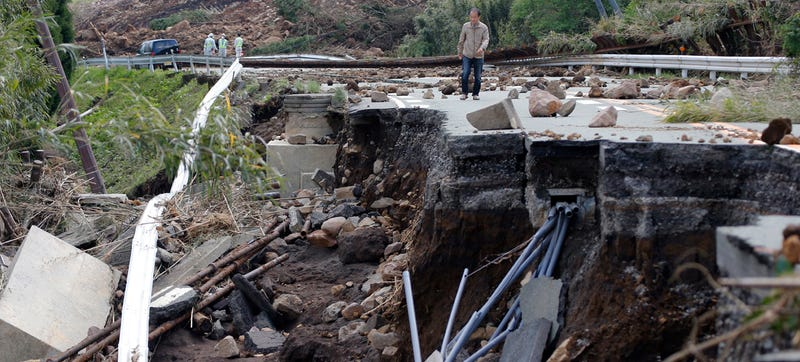 A man walks at a damaged area by earthquakes in Minamiaso, Kumamoto prefecture, Japan, Sunday, April 17, 2016. Two nights of increasingly terrifying earthquakes flattened houses and triggered major landslides in southern Japan. Photo credit AP