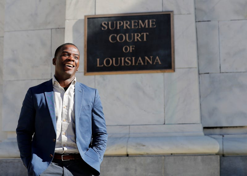 Theo Shaw, standing outside the Louisiana Supreme Court where he clerked for the chief justice, in late 2018.