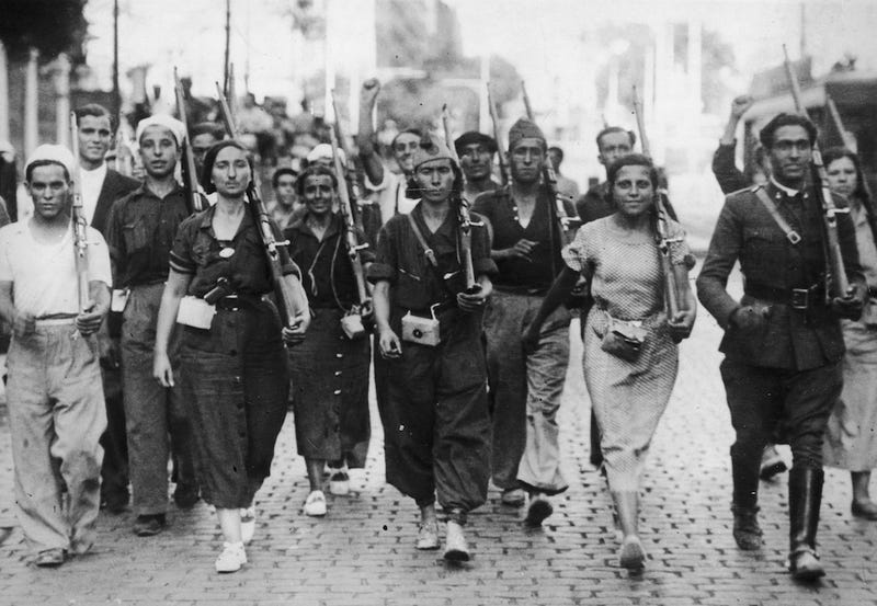 Illustration for article titled Female Militia Members March at the Beginning of the Spanish Civil War