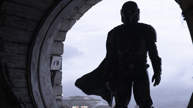 The Mandalorian enters.