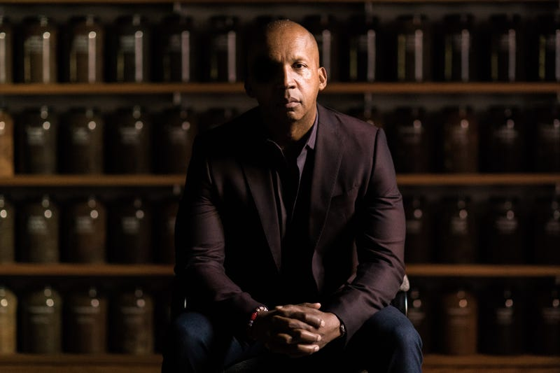 Bryan Stevenson in front of social collection jars, Equal Justice Initiative, 2018