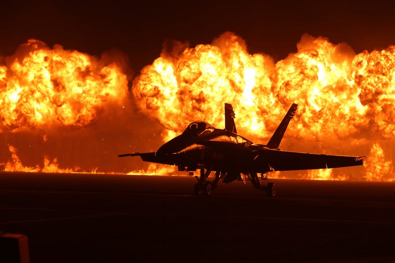 Illustration for article titled Spectacular photo of an F-18 against a huge wall of fire