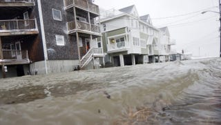 Coastal flooding in Scituate, Mass., during a winter storm last January, via Dave Malkoff/Flickr