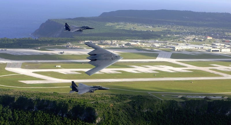 American F-15E Strike Eagles fly alongside a B-2A Spirit Stealth bomber over Andersen AFB on the island of Guam. USAF Photo