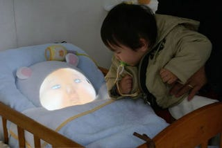 Illustration for article titled Japanese Baby Simulator Is 1,000 Times Creepier Than a Normal Baby