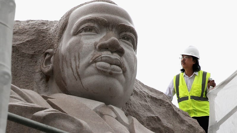 Sculptor Lei Yixin stands on top of a scaffolding to observe the statue of Martin Luther King Jr. on Aug. 1, 2013, at the Martin Luther King Jr. Memorial in Washington, D.C.