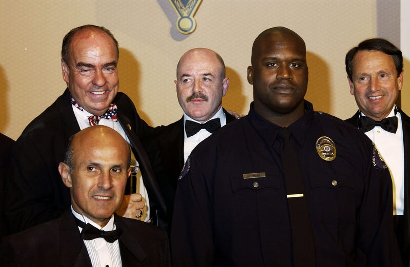 Shaquille O'Neal (second from right) and Los Angeles County Sheriff Lee Baca (left) attend the 2nd Annual California Gold Star Awards dinner gala and auction at the Disneyland Hotel on April 5, 2003, in Anaheim, Calif. The gala salutes outstanding law enforcement members and other citizens of California. (Robert Mora/Getty Images)