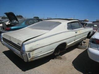Illustration for article titled Two Doors And A Fastback Can't Save This Once-Sporty 1968 Mercury Monterey From The Crusher!
