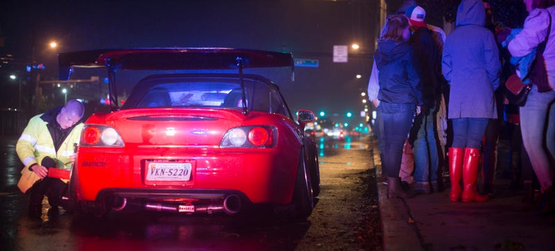 Another camber'd S2000 owned by Erick Sandoval (@erick_flow9) getting pulled over the same night as Junior, and only a few blocks away. Note that the cop has a camber-measuring device. Photo Credit: Raphael Orlove