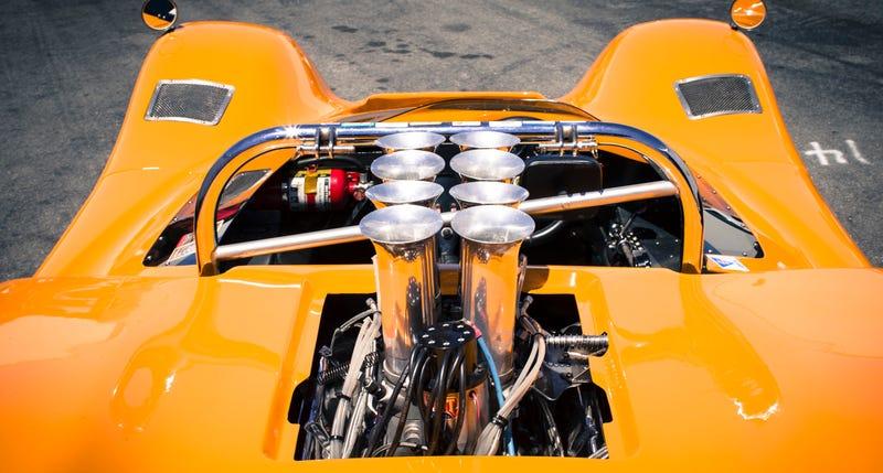 Eight beautiful intake trumpets above the Chevy V8-powered McLaren M6B at Laguna Seca's Monterey Historics. Photo Credit: McLaren