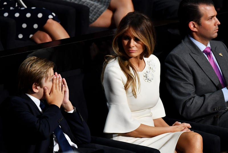 Barron Trump, Melania Trump and Donald Trump Jr. listen to then-Republican presidential candidate Donald Trump deliver his speech on the fourth day of the Republican National Convention on July 21, 2016, at the Quicken Loans Arena in Cleveland.