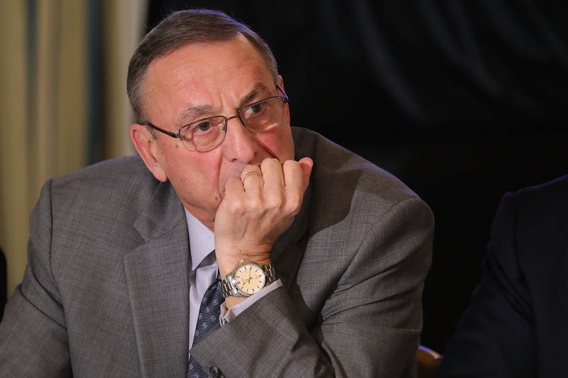 Paul LePage listens to U.S. President Donald Trump during meeting with state and local officials to unveil the Trump administration's long-awaited infrastructure plan in the State Dining Room at the White House February 12, 2018 in Washington, DC.