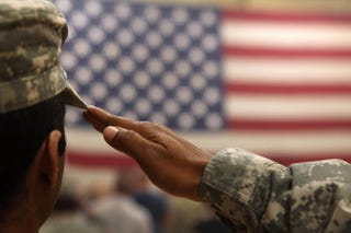 A soldier salutes the flag during a welcome-home ceremony for troops arriving in Fort Carson, Colo., from Afghanistan June 15, 2011.John Moore/Getty Images