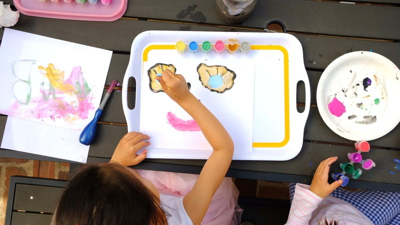 My daughter and her friend working on their masterpieces—all contained on serving trays,
