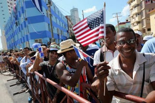Hundreds of Cubans and visitors from other countries gather across the street from the newly reopened U.S. Embassy to observe the flag-raising ceremony Aug. 14, 2015, in Havana.Chip Somodevilla/Getty Images