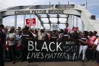 Thousands of people walk across the Edmund Pettus Bridge in Selma, Ala., during the 50th anniversary commemoration of the Selma-to-Montgomery civil rights march March 8, 2015.Justin Sullivan/Getty Images