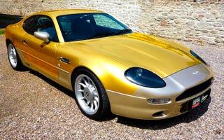"Illustration for article titled Gold Leaf ""Premium Bond"" Aston Martin DB7 Tackier Than Roger Moore"