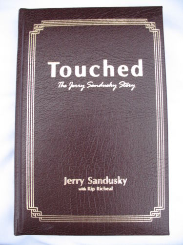 Illustration for article titled You Have Four Days Remaining To Bid On This Leather-Bound & Autographed Copy Of Jerry Sandusky's Book