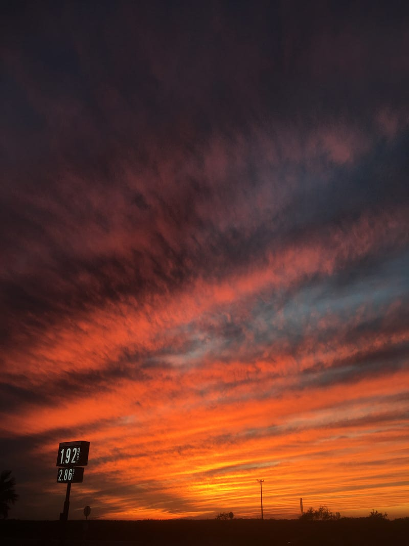Gorgeous sunset from a couple of months back. Also, those gas prices were rather nice, too.