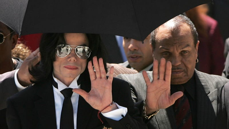 Michael Jackson and his father Joe Jackson (R) wave to fans as they exit the court after hearing the jury declare Not Guilty on all counts in the Michael Jackson child molestation trial at the Santa Barbara County Courthouse June 13, 2005 in Santa Maria, California. Jackson was charged in a 10-count indictment with molesting a boy, plying him with liquor and conspiring to commit child abduction, false imprisonment and extortion.