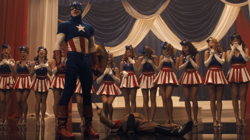 While Iron Man was turning Tony Stark into a modern day tech bro and Thor explained away magical gods with science and aliens, The First Avenger put Chris Evans in a goofy-ass retro costume and had him punch Hitler mid-showtune. YOUR FAVE COULD NEVER.