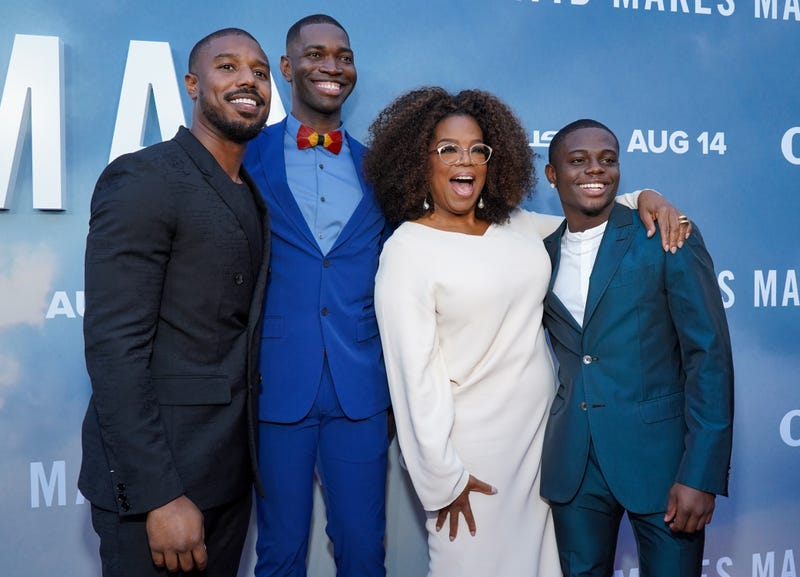 Michael B. Jordan, left, Tarell Alvin McCraney, Oprah Winfrey and Akili McDowell attend the premiere of OWN's David Makes Man at NeueHouse Hollywood on Aug. 6, 2019, in Los Angeles.