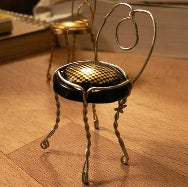 Illustration for article titled Craft a Tiny Chair from Champagne Cork Holders