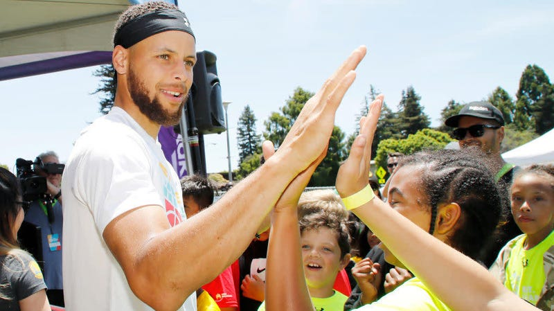 Steph Curry greeting kids at the launch of his Eat. Learn. Play. Foundation on July 18, 2019, in Oakland, Calif.