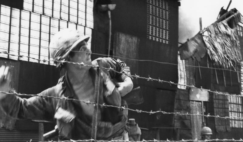 GI of the U.S. 9th Infantry Division throw a Grenade into a suspected Viet Cong position during battling in the southern part of Saigon in 1968. Image by Merick's War Torn co-author, Jurate Kazickas/AP.