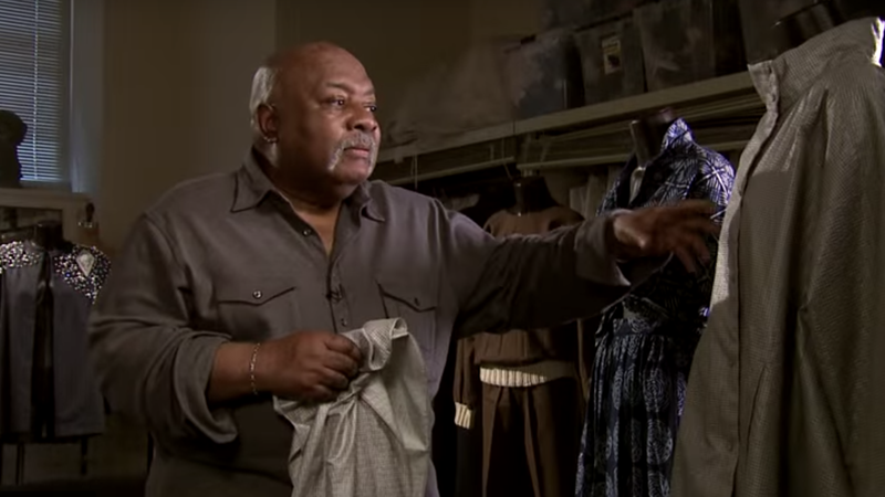 """""""Grandfather of Fashion"""" Arthur McGee, seen here with some of his archived designs in 2014, died on Monday, July 1, 2019."""
