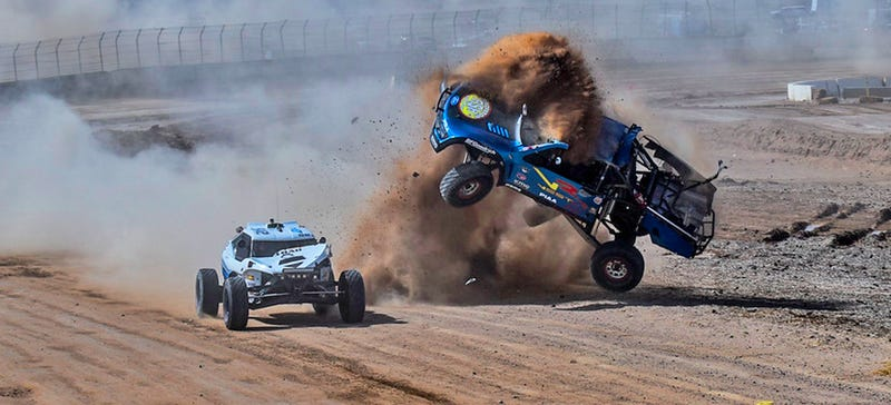 Illustration for article titled Holy Crap: Tiny Buggy Hip-Checks A Trophy Truck Into Oblivion Mid-Race