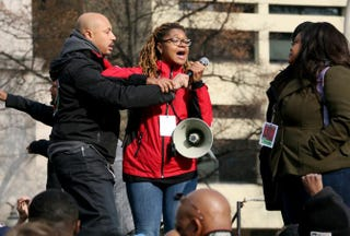 Erika Totten (center) struggles for the microphone to ensure that her voice would be heard during the Justice for All march on Saturday. Nicole L. Cvetnic/The Root