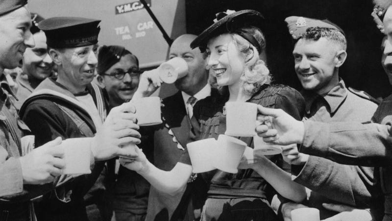 Forces Sweetheart Vera Lynn, acting on behalf of the Variety Artistes Ladies' Guild, presented a mobile canteen to the mayor of Westminster who accepted it on behalf of the YMCA. Here she serves the first cups of tea to servicemen from the canteen, which is stationed in Trafalgar Square. Photo via Getty Images.