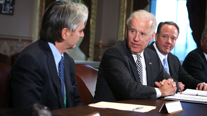 Then-Vice President Joe Biden (C) speaking with John Riccitiello, then CEO of Electronic Arts (L), and Mike Gallagher, then CEO of the Entertainment Software Association (R), in 2013.