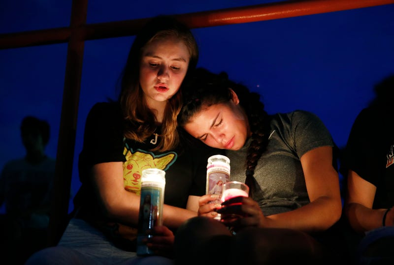 Melody Stout and Hannah Payan comfort each other during a vigil for victims of the shooting that occurred earlier in the day at a shopping center, Aug. 3, 2019, in El Paso, Texas.