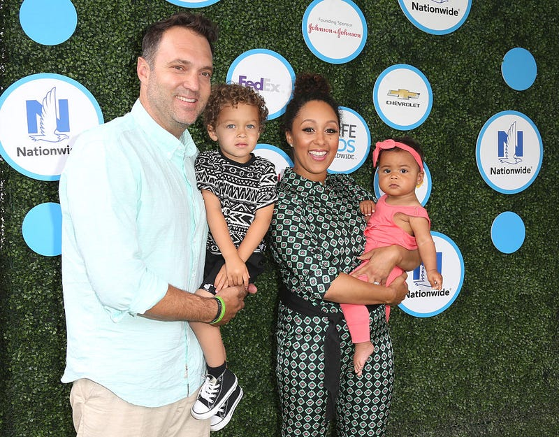 Tamera Mowry-Housley (second right) and family (Frederick M. Brown/Getty Images)