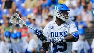 Myles Jones #15 of the Duke Blue Devils looks to pass against the Notre Dame Fighting Irish during the second half of the 2014 NCAA Division I Men's Lacrosse Championship at M&T Bank Stadium on May 26, 2014 in Baltimore, Maryland. Rob Carr/Getty Images