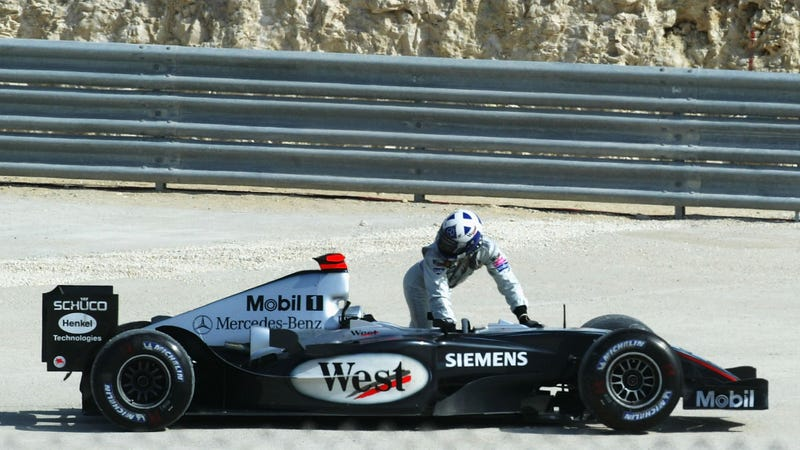 David Coulthard after spinning out in practice at the 2004 Bahrain GP, later to become controversial when F1 continued amidst the country rising up against its dictatorship government. Note the now-banned cigarette sponsorship on the car. Photo: Getty Images