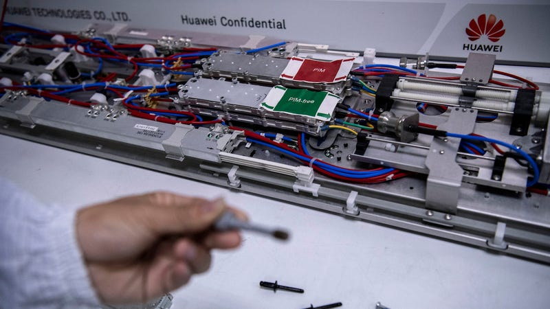 A Huawei engineer displays parts in the research and development area of the Bantian campus on April 12, 2019 in Shenzhen, China.