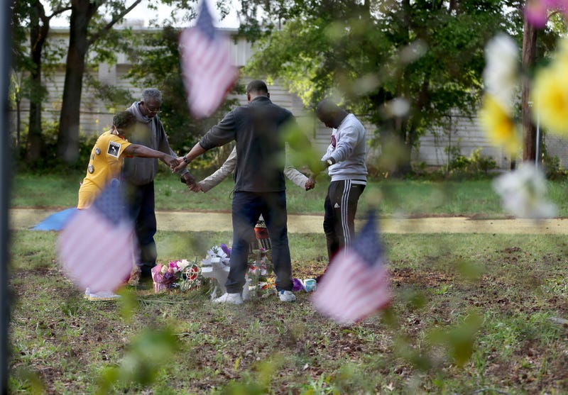 People join hands in prayer as they visit a memorial set up on the site where Walter Scott was killed April 11, 2015, in North Charleston, S.C. (Joe Raedle/Getty Images)