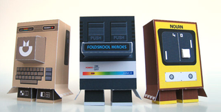 Illustration for article titled Papercraft Retro Game Consoles Will Adorn Your Cubicle With Geekery on the Cheap