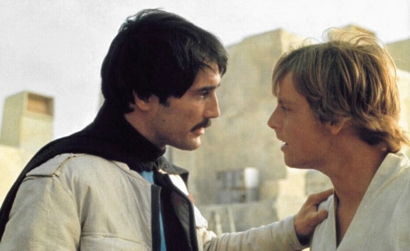 Luke Skywalker and Biggs Darklighter talk on Tatooine in the original Star Wars directed by George Lucas