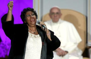 Aretha Franklin performs at the Festival of Families as Pope Francis looks on Sept. 26, 2015, in Philadelphia.Carl Court/Getty Images